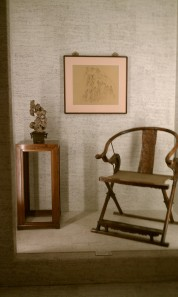 Chinese art: Ancient furniture and modern painting. Note scholar stone on table.