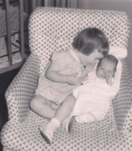 Me at 17 months, and my newborn brother