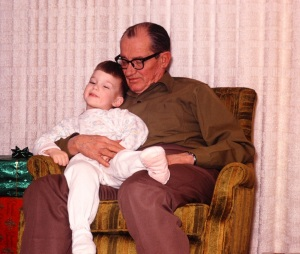 My paternal grandfather and my brother -- note the footie pajamas (though these are pink, so they may be hand-me-downs from my sister)