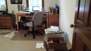 My desk, as I write this post. Note how I file on the floor. It's worked for me for 35 years.