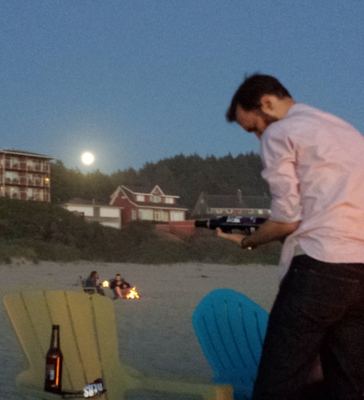 My son (with beer, not s'mores) on the beach, with the full moon rising