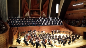 Kansas City Symphony warming up on October 24, 2015, with chorus behind them