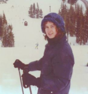 T in down jacket skiing 2-79 cropped