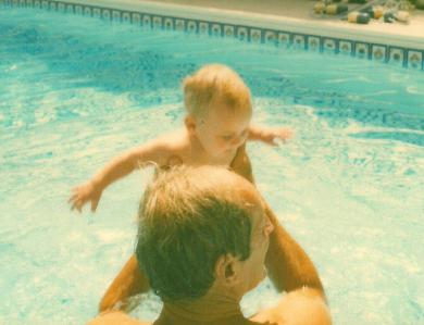 J & Grandpa in pool close up.jpg